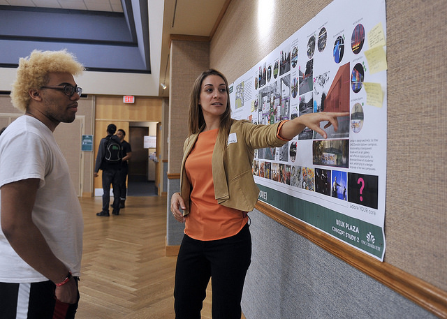 Attendees discuss their feedback at Arts Corridor station