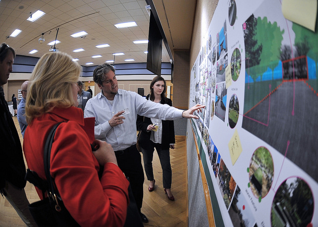 LandDesign representative points areas of interest on boards